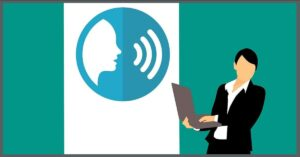 communication graphic of a person standing with laptop