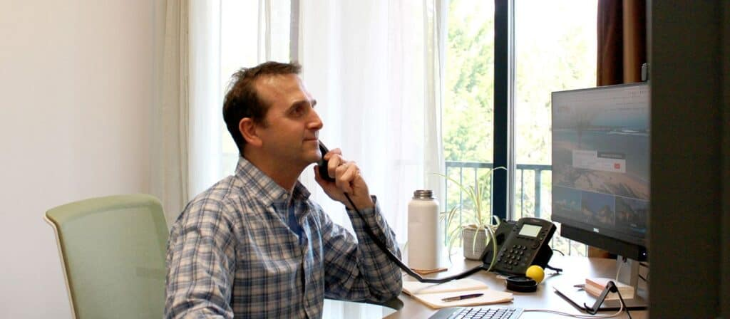 man on the phone in office